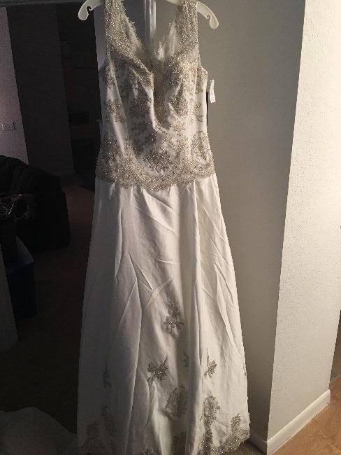 Never worn lace wedding gown